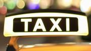 Close up of illuminated taxi sign
